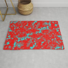 A interweaving cluster of red bodies on a light blue background. Rug