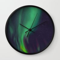 northern lights Wall Clocks featuring northern lights by Ewa Pacia