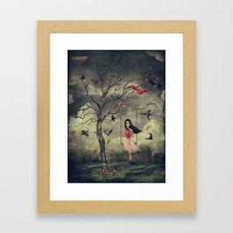 Girl on a swing in the woods Framed Art Print