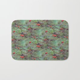 Small rosehips on bare branches Bath Mat
