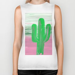 green cactus emerges in front of a multi colored sky Biker Tank