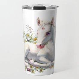 Baby unicorn lies in flowers Travel Mug