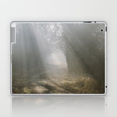 Sunlight through mist along a remote country track. Norfolk, UK. Laptop & iPad Skin