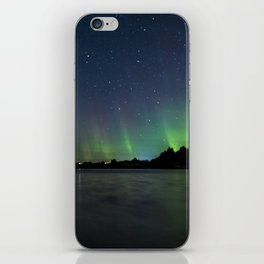 Northern Lights above a lake iPhone Skin