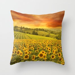 Red sunset over the rolling sunflowers and sunflower fields of Tuscany, Italy Throw Pillow