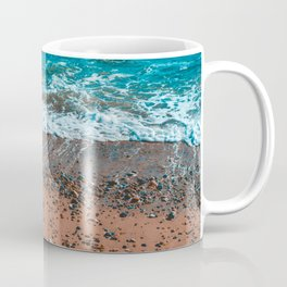 Orange bay with small stones and beautiful waves Coffee Mug