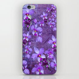 purple orchids on a textured wall iPhone Skin