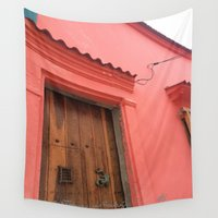 colombia Wall Tapestries featuring Cartagena is Peachy, Colombia, South America. Coral Pink Building with Ornate Lizard design by ANoelleJay