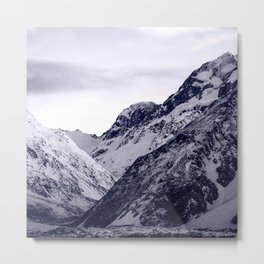 Snow-Covered Rocky Mountains Covered By Moody Sky Metal Print