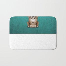 Cute Lion Cub Dj Wearing Headphones on Blue Bath Mat
