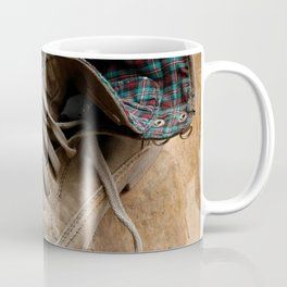 Pair of old leather shoes, worn-out and dusty, on wooden background Coffee Mug