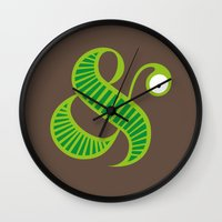 et Wall Clocks featuring Et worm by Robert Karpati