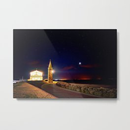 Church and lighthouse on the sea coast Metal Print