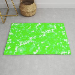 A bright cluster of green bodies on a light background. Rug