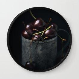 Ripe fresh cherry in a metal mug on a dark background Wall Clock