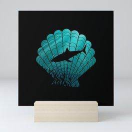 Black Shark inside a seashell Mini Art Print