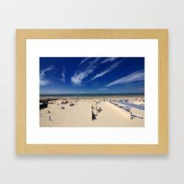 On the beach, blue sky Framed Art Print