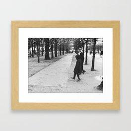 Child skipping, Jardin des tuileries, Paris 2012 Framed Art Print