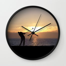 Playing Golf At Sunset Wall Clock