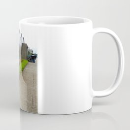 the metal ball and the small garden Coffee Mug