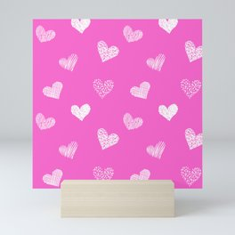 Hand drawn doodle hearts on pink board Mini Art Print