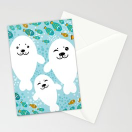 happy family of white seals and fish on a blue background. Stationery Cards