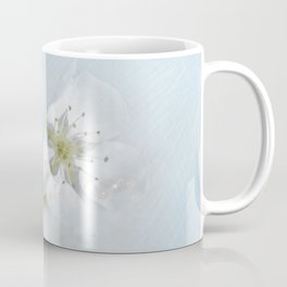 On the table lay the flower of a wild pear ... Coffee Mug