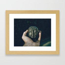 buddha head in hand Framed Art Print