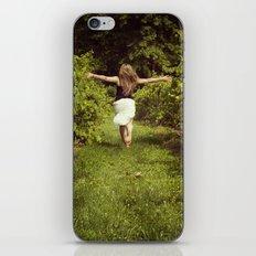Young woman running through a vineyard iPhone & iPod Skin