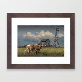 Longhorn Steer in a Prairie pasture by 1880 Town with Windmill and Old Gray Wooden Barn Framed Art Print