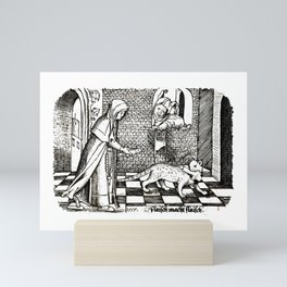 Nun tempting a cat with a fish Mini Art Print