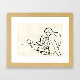 Reading in the beach Framed Art Print