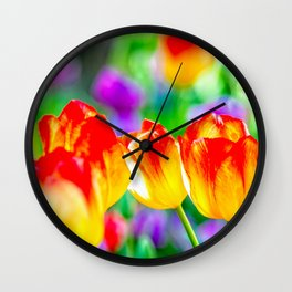Group Of Yellow Tulip Flowers With Red Tops. Abstract Of Spring Wall Clock