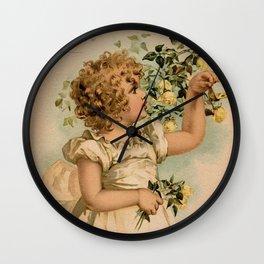 Little girl picking yellow roses Maud Humphrey Wall Clock