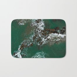 Rocks in the sea Bath Mat