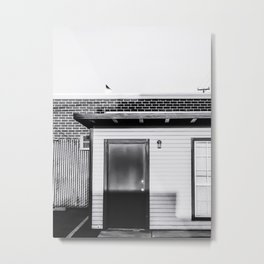 wood building with brick building background in black and white Metal Print