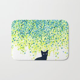 Cat in the garden under willow tree Bath Mat