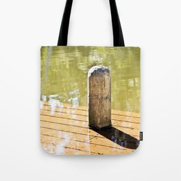 Waterlogged pier. Tote Bag