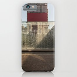 Modern fountain with water splashes on a huge glass window cut by the shadow iPhone Case