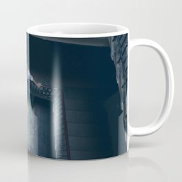 In the middle Coffee Mug