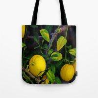 berserk Tote Bags featuring Winter Lemons by oneofacard