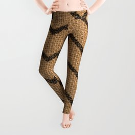 Vintage asian traditional chevron on dark fabric texture Leggings