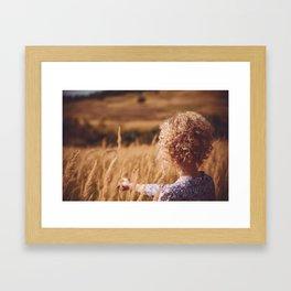 Girl in the field Framed Art Print