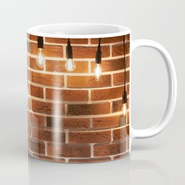 brick wall and decorative incandescent lamps Coffee Mug