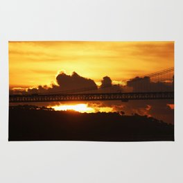 Dramatic sunset with bridge Rug