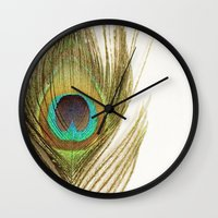 peacock feather Wall Clocks featuring Peacock Feather by Kimberly Blok