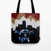 robocop Tote Bags featuring RoboCop by iankingart