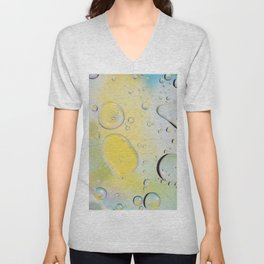 Oil drops in water. Defocused abstract psychedelic pattern image green, yellow and white gradient colored. DOF. Unisex V-Neck