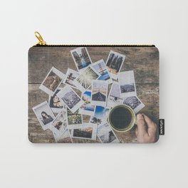 Polaroids prints on a wooden table Carry-All Pouch