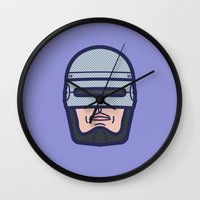 robocop Wall Clocks featuring ROBOCOP by M. Gulin
